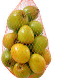 Jujube Fruits or Indian Plum. In net bag against white background Stock Photo