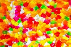 Jujube i form för sockerfrånvaroben, färgrik abstrakt texturbakgrund, tillbaka ljus, closeup Royaltyfri Fotografi