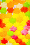 Jujube in sugar absence star shape, colorful abstract texture background, back light, closeup Stock Photos