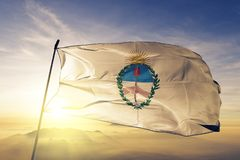 Jujuy province of Argentina flag textile cloth fabric waving on the top sunrise mist fog. Beautiful stock photography