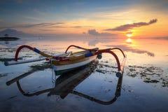 Jukung Traditional Bali Fishing Boat. On sunrise near sanur beach facing the ocean Stock Photography