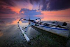 Jukung Traditional Bali Fishing Boat. On sunrise near sanur beach facing the ocean Royalty Free Stock Photo