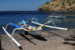Jukung traditional small wooden Balinese outrigger canoe royalty free stock photos