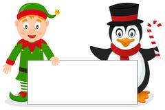 Jul älva & pingvin med banret Royaltyfri Bild