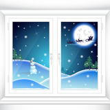 Jul bak ett fönster Fotografering för Bildbyråer