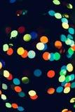 Jul bakgrund för det nya året med härlig bokeh av den färgrika girlanden tänder Royaltyfri Fotografi