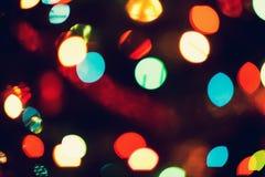 Jul bakgrund för det nya året med härlig bokeh av den färgrika girlanden tänder Arkivfoto