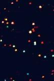 Jul bakgrund för det nya året med härlig stjärnabokeh av den färgrika girlanden tänder Arkivbilder