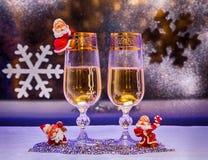 Jul champagne leksakgnomer Arkivfoto