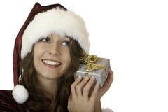 jul claus som rymmer den aktuella santa kvinnan Arkivbild