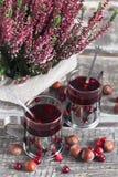 Jul dricker, ljung, muttrar och tranbär Royaltyfria Foton