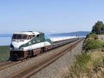 Jul 14, 2018; Edmonds, WA, USA; Amtrak F59PHI 466. Leading Amtrak`s Cascade Service 517 passes the Edmonds waterfront on a clear summer day with Mount Baker in stock image