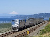 Jul 14, 2018; Edmonds, WA, USA; Amtrak P42 48. Leading Amtrak`s Empire Builder Service 8 passes the Edmonds waterfront on a clear summer day with Mount Baker in royalty free stock photography