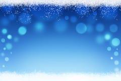 Jul eller abstrakt bokehbakgrund för vinter med snö Arkivbild