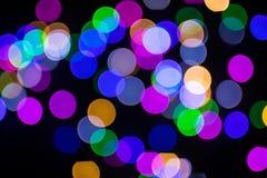 Jul feriebakgrund Abstrakt färgbokeh i natten royaltyfria bilder