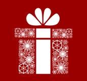 Jul gåva för ` s för nytt år Vita snöflingor på ett rött Royaltyfria Foton