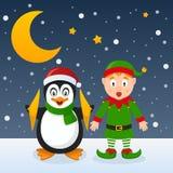 Jul gör grön älvan och den gulliga pingvinet Royaltyfri Fotografi