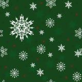 Jul gör grön den sömlösa modellen med vita snöflingor Royaltyfri Fotografi
