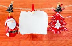 Jul garnering och tömmer det pappers- arket Arkivbilder