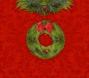 Jul girland och krans mot en röd damast vägg royaltyfri fotografi