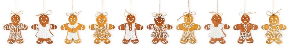 Jul gränsar och smyckar från pepparkakapojkar och flickor på rep - söta kakor arkivfoton