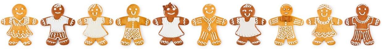 Jul gränsar och smyckar från pepparkakapojkar och flickor - söta kakor arkivbilder