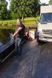 Jul. 2017, Graepel, germany, hand-operated pontoon ferry with car. In germany royalty free stock images