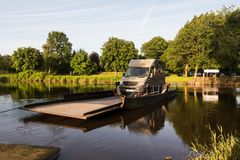 Jul. 2017, Graepel, germany, hand-operated pontoon ferry with car. Ior RV in germany royalty free stock photography