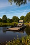 Jul. 2017, Graepel, germany, hand-operated pontoon ferry with car. Ior RV in germany royalty free stock photos