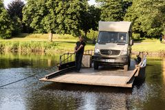 Jul. 2017, Graepel, germany, hand-operated pontoon ferry with car. Ior RV in germany royalty free stock image