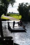 Jul. 2017, Graepel, germany, hand-operated pontoon ferry with car. Ior RV in germany stock photography