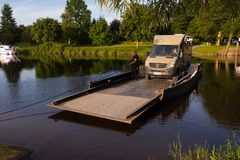 Jul. 2017, Graepel, germany, hand-operated pontoon ferry with car. Ior RV in germany royalty free stock images