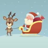 Jul hjortar och Santa Claus Royaltyfri Foto