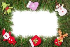 Jul inramar gjort av granfilialer som dekoreras med den isolerade snögubben och Santa Claus på vit bakgrund Royaltyfri Foto