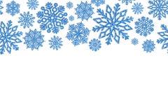 Jul inramar med blåa snöflingor Gräns av paljettkonfettier arkivbild