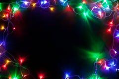 Jul inramar med felika ljus. Arkivbilder