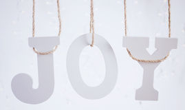 Jul Joy Letters Hanging From Twine Fotografering för Bildbyråer