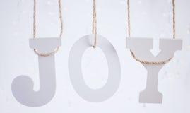 Jul Joy Letters Hanging From Twine Fotografering för Bildbyråer