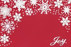 Jul Joy Sign och snöflingagarneringar arkivfoton