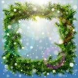 Jul kvadrerar kransen med över huvudet belysning och snöfall Arkivfoton