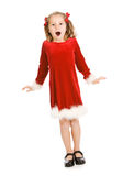 Jul: Liten flicka som mycket är upphetsad för jul royaltyfria foton