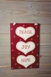 Jul märker med massager av fred, glädje och hopp Arkivfoto