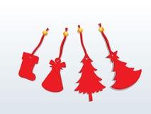 Jul med röda prydnader, lyckligt nytt år och garnering Arkivfoton