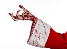 Jul- och allhelgonaaftontema: Santa Zombie blodig hand på en vit bakgrund Royaltyfri Bild