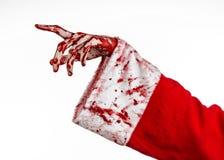 Jul- och allhelgonaaftontema: Santa Zombie blodig hand på en vit bakgrund Arkivbilder