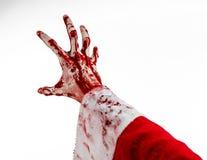 Jul- och allhelgonaaftontema: Santa Zombie blodig hand på en vit bakgrund Fotografering för Bildbyråer