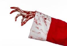 Jul- och allhelgonaaftontema: Santa Zombie blodig hand på en vit bakgrund Arkivfoton