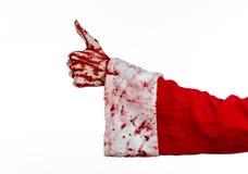 Jul- och allhelgonaaftontema: Santa Zombie blodig hand på en vit bakgrund Royaltyfri Foto
