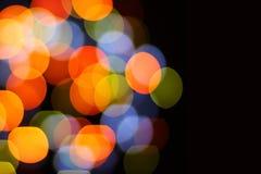 Jul och lyckligt nytt år på en suddig bokeh Att glo suddig tom bakgrund royaltyfri foto