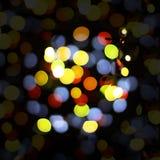 Jul och lyckligt nytt år på en suddig bokeh Att glo suddig tom bakgrund arkivbild